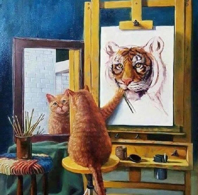 кот рисует картину